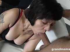 Two sex-starved guys fuck mouth and pussy of whore granny in red-hot stockings