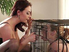 Women at bottom high heels in super intense caged femdom