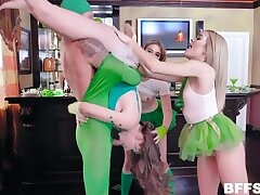 People in funny green costumes enjoy reverse gangbang party