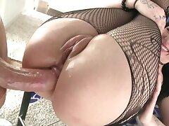Fucker drills ass of brunette in fishnets in gonzo porn video